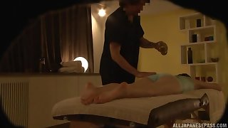Japanese babe pays for an oily massage with a blowjob